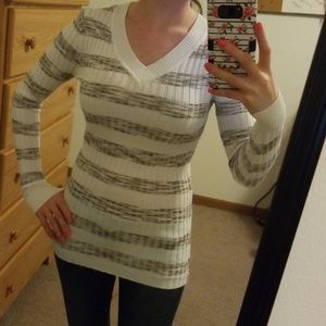 Gray and white striped v neck sweater.